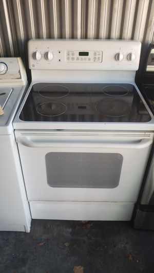 White GE range working great delivery available for Sale in Kissimmee, FL