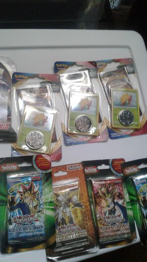 4 pokemon and 4 yugioh packs, check the bonus on the yugiohs . Pickup tracy only for Sale in Tracy, CA