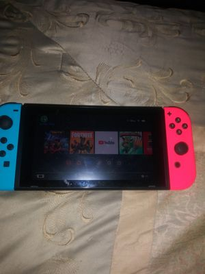 Nintendo switch for sale asking 190 only comes with charger and the two handles and table for Sale in Las Vegas, NV