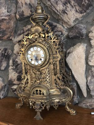 Antique Italian brass candelabra clock. Winds and dings every hour and half hour for Sale in Moreno Valley, CA