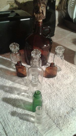 Old antique glass bottles (Avon perfume,medicine, liquor, etc) for Sale in Marietta, GA