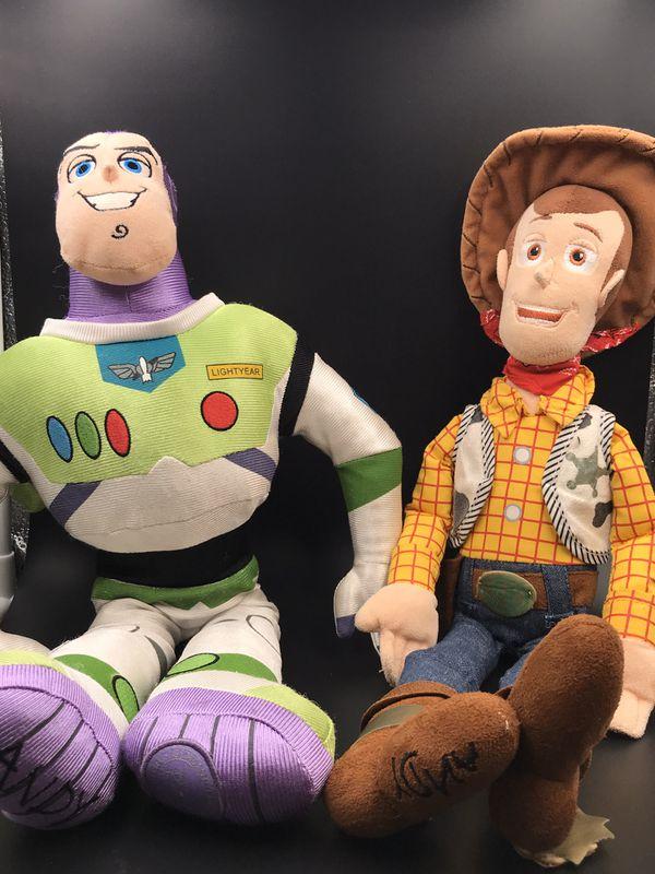 Buzz and woodie Disney dolls