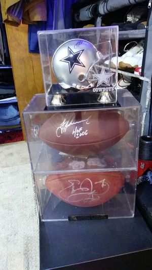 Autographed Dallas Cowboys items. Troy Aikman HOF ball. Emmitt Smith ball and Troy Aikman mini helmet all three are in cases and come with COA for Sale in US