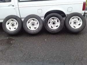 Ford truck rims and tires snow Groove 80% tread for Sale in Portland, OR