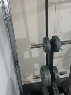 Olympic weights with barbell & clips for Sale in Oregon City,  OR