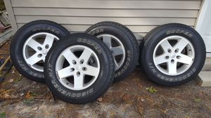 Excellent Upgraded Jeep Wheels with descent tires 245/70/17. Small road rash on 1 wheel for Sale in Carver, MA