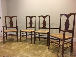Four farmhouse style ladder back table chairs (includes two arm chairs). Cherry wood with cane seats. Excellent condition. for Sale in Falls Church, VA