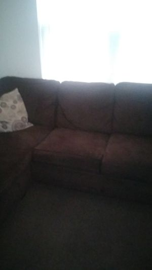 3 seat couch with a reversable ottoman for Sale in St. Louis, MO
