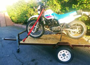 Yamaha xt350 and trailer street legal dirt bike for Sale in Las Vegas, NV