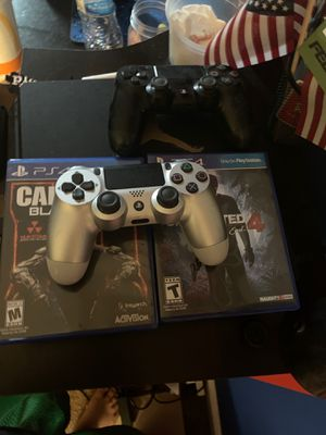 PS4 slim with 2 controllers and 2 games for Sale in Sterling, VA