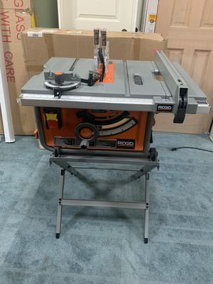 RIDGID 15 Amp Corded 10 in. Compact Table Saw with Carbide Tipped Blade and Folding X-Stand for Sale in Houston, TX