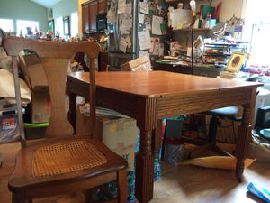 Oak table with 4 cane seat chairs + two leafs for Sale in Versailles, KY