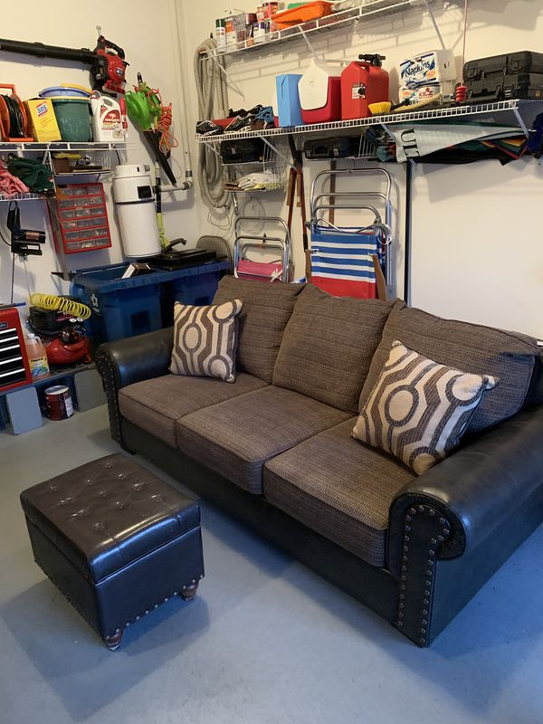 Brand new beautiful 3 person leather / fabric couch.
