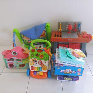 Huge lot kids toys walker, games, Fisher price pet shop and workbench for Sale in Pembroke Pines, FL