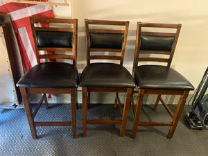 Three wood and leather bar stools! Small Place of damage just from the move. Otherwise is wonderful condition and high quality. for Sale in San Diego, CA