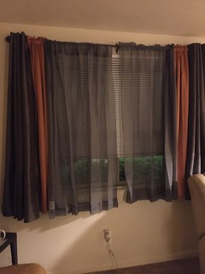 2 gray sheers, 2gray satin panels and 2 orange/peach satin curtains for Sale in Baltimore, MD