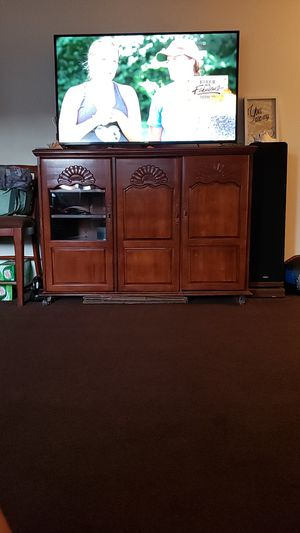 Solid tv stand with plenty of room for storage . Has wheels on the bottom for easier moving. Pick up only! Make me an offer for Sale in Mesa, AZ