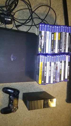 PS4 pro 5gb, 1 wireless controller, 29 games on disk, and cords for Sale in Tonto Basin, AZ