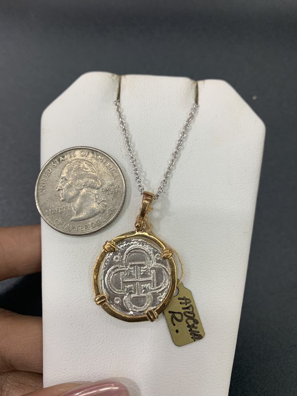 Beautiful Atocha silver coin pendant in gold bezel with silver chain