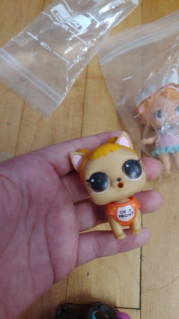 3 pet lols and 1 lol doll