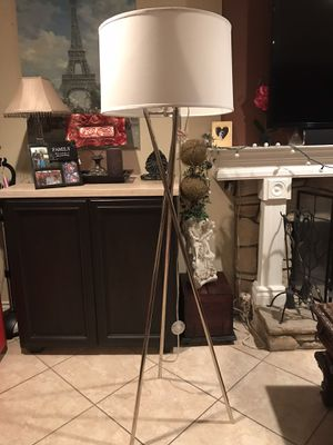 "One Tripod Floor Lamp.Tripod base draws the eye to this Brushed Steel floor lamp while its shade adds a crisp touch to your decor.63"" High for Sale in Lake Forest, CA"