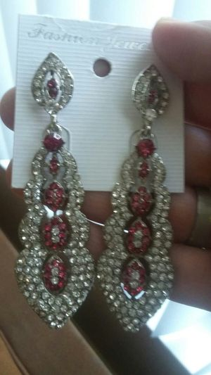 Earrings full silver colour and pink stone for Sale in Moreno Valley, CA