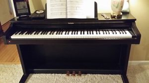 Technics electronic piano- full size keyboard, many sound like organ, strings, built in metronome and recording capabilities. for Sale in Frederick, MD