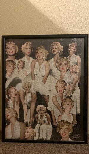A Marilyn Monroe puzzle!! Super old puzzle put together years ago by my grandma!! 17 different poses of her in the famous white, float dress!! for Sale in Payson, AZ