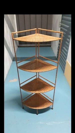 Beautiful wicker wrapped around a metal frame. Four tier shelving corner unit for Sale in Oakland, CA