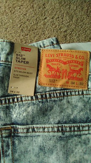 Levi's jeans stone washed slim taper 34/32 also have in blk dark n light blue for Sale in Denver, CO
