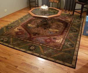 Rug 8x10. Purchased from Pottery Barn and octagon glass top coffee table . Excellent condition. Ready for your home for Sale in Bolingbrook, IL