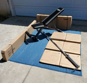 EXERCISE FITNESS EQUIPMENT SQUAT RACK/7FT 45LB OLYMPIC BAR/SPRING COLLARS/BUMPER PLATES AND ADJUSTABLE WEIGHT BENCH for Sale in Riverside, CA