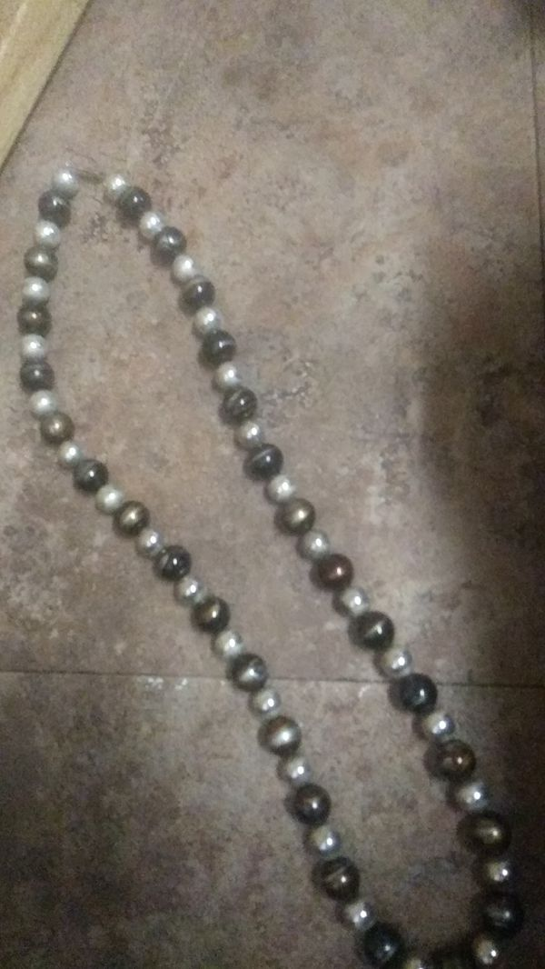Lady's long beaded necklace