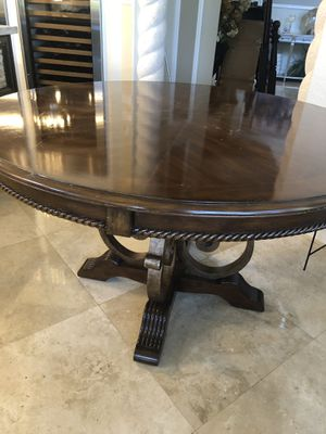 Solid wood breakfast table with brass accent and solid base. 55 diameter 30 high. for Sale in Parkland, FL