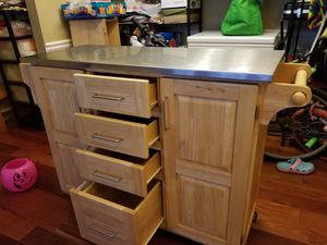 Knich kitchen island with stainless steel top for Sale in Alexandria, VA