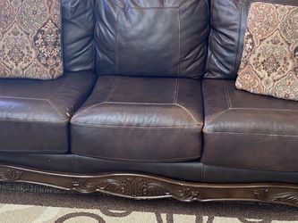Two Piece Leather Sofa Set, Walnut Color, Wood Finish. Thr Leather Is Little Scuff But Still In Very Good Conditions. for Sale in Eagle Mountain,  UT