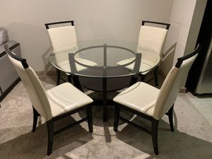 Glass Top Dining Table with Wooden Base and 4 Cream Leather Chairs for Sale in Arlington, VA