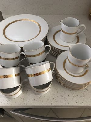 Dinning set 34 pieces with golden pattern in good condition or make reasonable offer for Sale in Fresno, CA