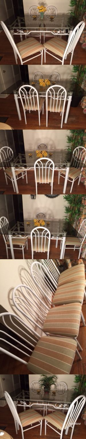 Kitchen table glass top 5' x 3' and 4 Chairs very good condition pick up from North Olmsted for Sale in Fairview Park, OH