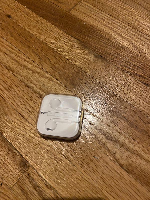 Authentic new Apple headphones with headphone jack