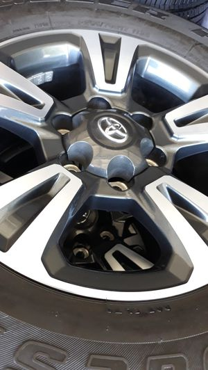 SET OF 4 TOYOTA TACOMA RIMS AND TIRES, ALSO FITS 4 RUNNER, FJ AND OLDER TUNDRAS. TIRE SIZE 265/70R17. WITH ABOUT 8/32' ON TREADS, TIRES FROM 2016. for Sale in Henderson, NV