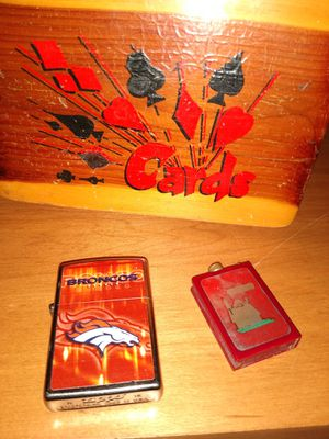 Cedar playing card box no cards Zippo Denver bronco lighter collectible Flint strike Snoopy lighter for Sale in Grand Junction, CO