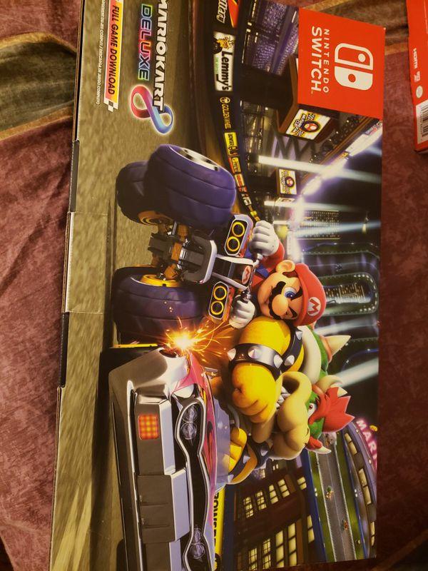 Nintendo switch Mario kart 8 edition/ limited edition Nintendo switch red joycon controls with red mario pouch and 20$ nintendo ecard