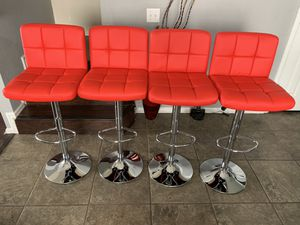 Brand new set of 4 red (plush) bar stools / red pub stools (height adjustable and swivel) for Sale in San Antonio, TX