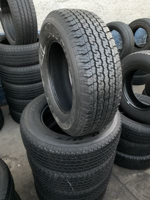 265/65/17 set of Bridgestone tires installed for Sale in Rancho Cucamonga, CA