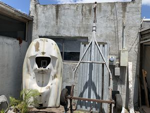 Small 1940s lake boat and trailer. One wheels rolls poorly. for Sale in Pompano Beach, FL