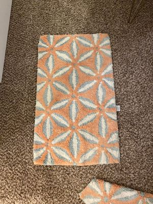 2 coral/blue flower bath mats for Sale in Austin, TX