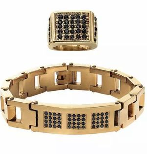 """Free 2 year protection plan 2-pc. set includes bracelet and ring Goldtone stainless steel Black crystal accents Bracelet is 8-1/2"""" long with foldove for Sale in Los Angeles, CA"""