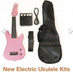 Electric guitar Ukulele with simple amp ( pink color) for Sale in Los Angeles, CA