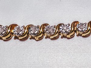1/2ct. DIAMOND GOLD OVER STERLING SILVER BRACELET for Sale in Fontana, CA